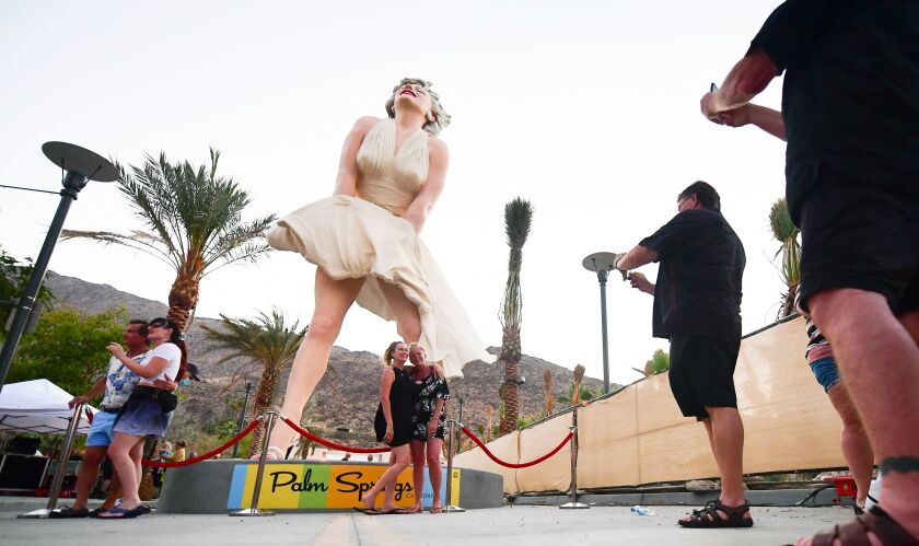 People visit the Forever Marilyn in Palm Springs.