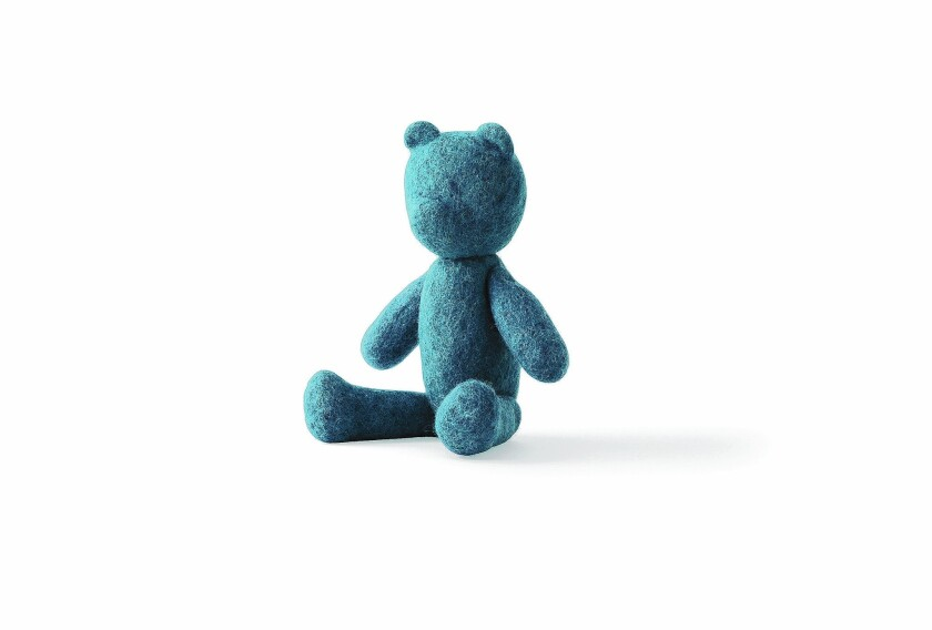 This teddy bear is from the Nepal Projects line, made by at-risk workers in Nepal trained by designers from Scandinavian firms.