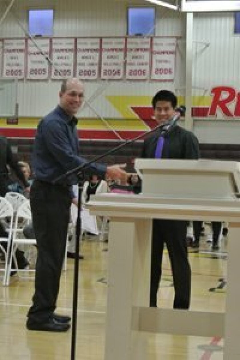 (L-R) Spencer Wong; Spencer Wong receiving his perfect attendance award from Steve Strimple (SFC college counselor), on May 7 at the Santa Fe Christian High School awards night.