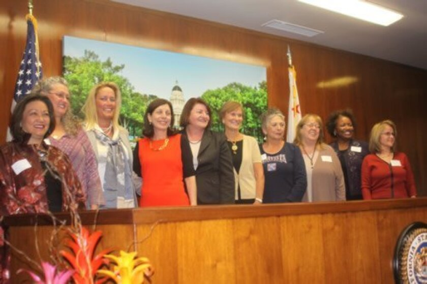 The nine Women of the Year with State Assemblymember Toni Atkins at the close of the ceremony are Patricia Ann Yim Cowett, Gerri Retman-Opper, Cindy Greatrex, Barbara Bry, Toni Atkins, Betty Jones, Linda LeGerrette, Mayda Winter, Patricia McQuater and Nancy Weare.