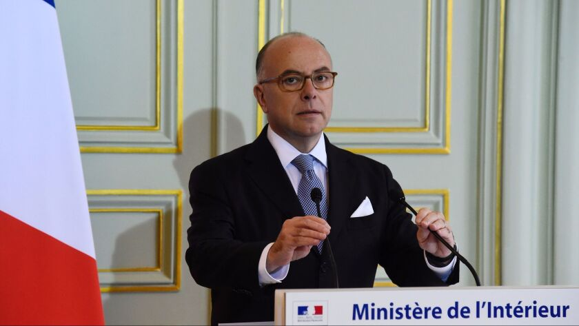French Interior Minister Bernard Cazeneuve prepares to speak at a news conference on Monday in Paris.