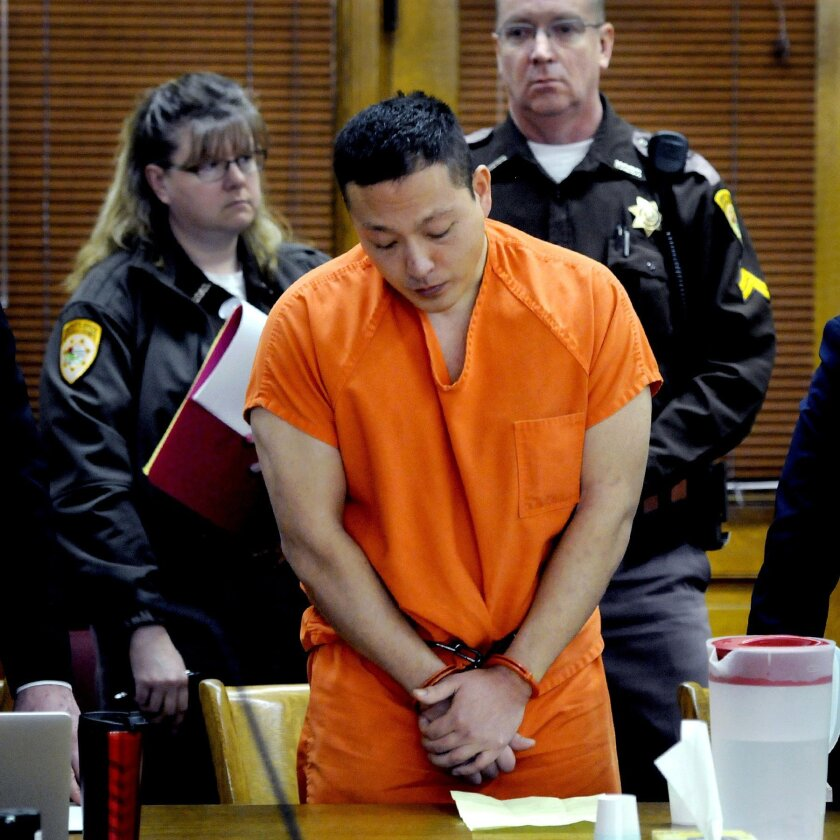 Markus Kaarma stands in Missoula County District Court while Judge Ed McLean sentences him to 70 years in prison for the shooting death of German exchange student Diren Dede on Thursday, Feb. 12, 2015 in Missoula, Mont. Kaarma shot 17-year-old Dede, who was unarmed, last year after he was alerted b