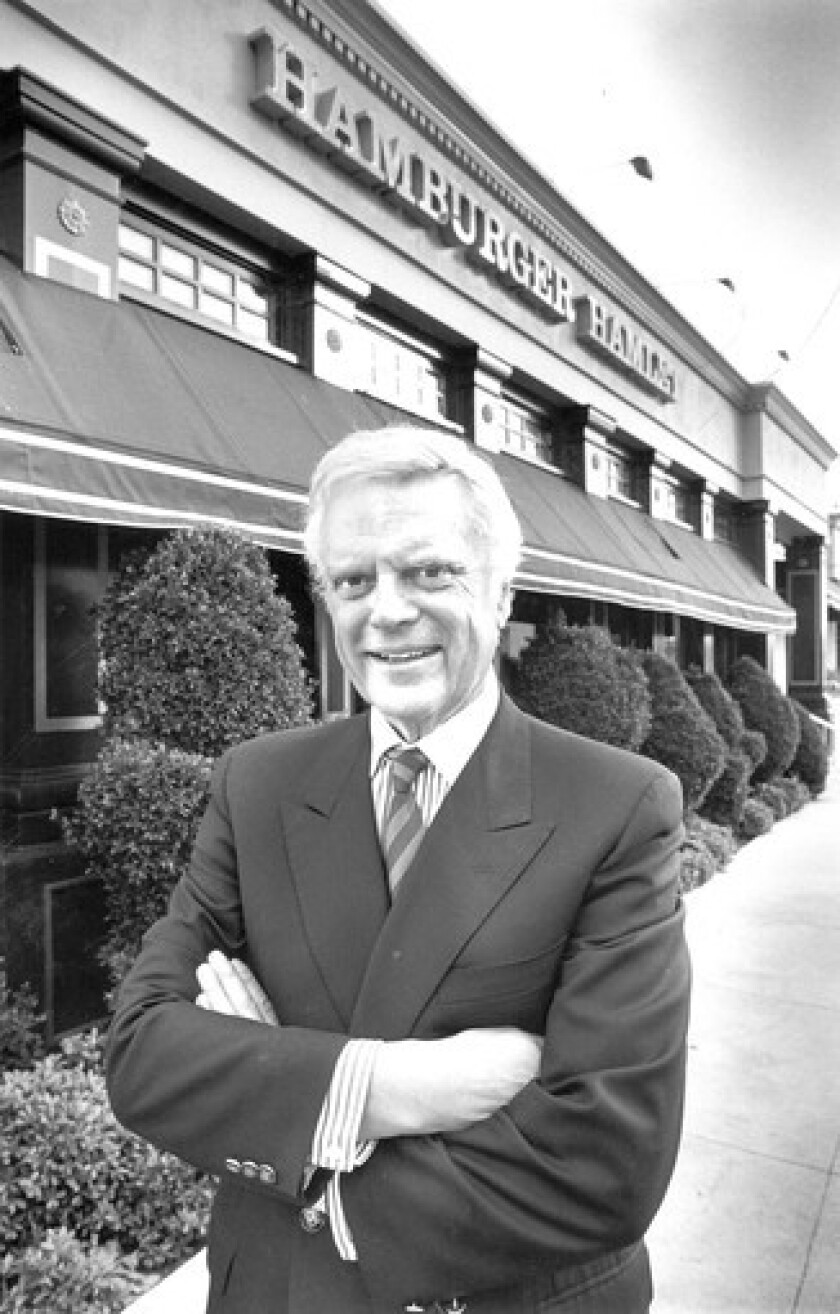 Harry Lewis, founder and president of Hamburger Hamlet, in front of his Brentwood location in 1987.