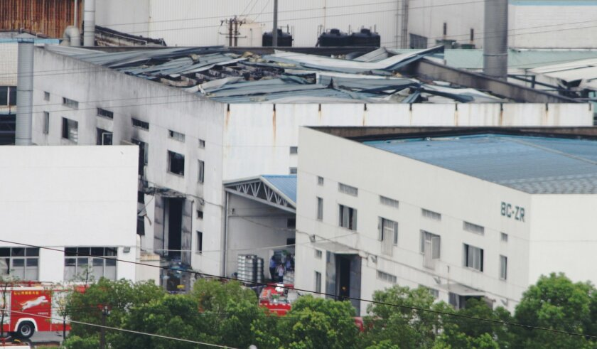 This photo released by China's Xinhua News Agency shows the damaged workshop following an explosion at an eastern Chinese automotive parts factory in Kunshan, Jiangsu Province Saturday, Aug. 2, 2014. Dozens of people were killed Saturday by the explosion at the factory that supplies General Motors, state media reported. (AP Photo/Xinhua, Zhu Guigen) NO SALES
