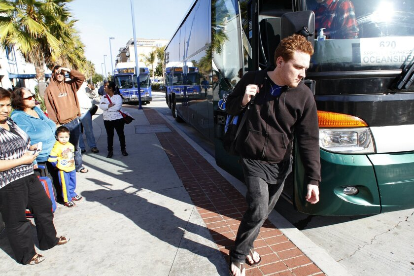 A bus rider departs a Sprinter replacement bus at the Oceanside Transit Center on Wednesday. North County's Sprinter light rail was shut down indefinitely March 9 due to brake problems.