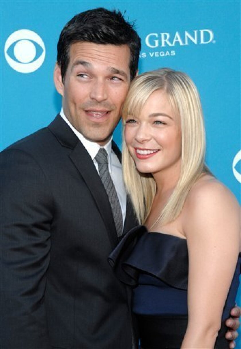 FILE - In this April 18, 2010 file photo, country singer LeAnn Rimes, right, and actor Eddie Cibrian arrive at the 45th Annual Academy of Country Music Awards in Las Vegas. (AP Photo/Dan Steinberg, file)