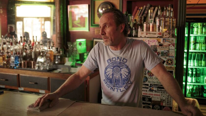 Greg Smith, 59, behind the bar at his Greenlight Tavern in Pueblo.