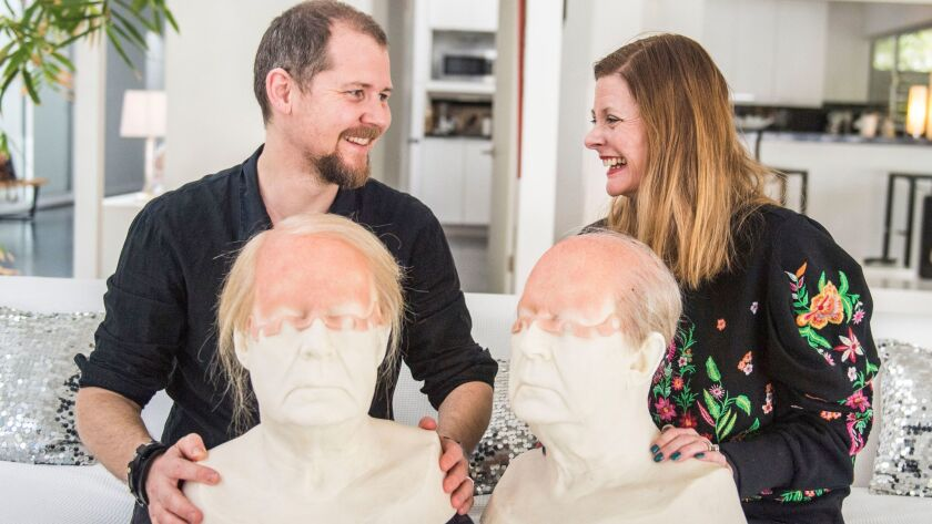 """Love Larson, left and Eva von Bahr, right, hold face casts of actor Rolf Lassgård from the show """"A Man Called Ove."""""""