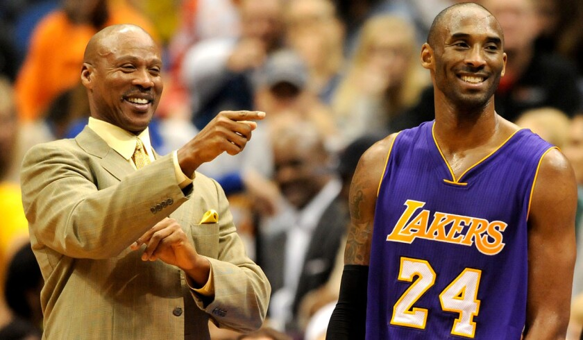 Lakers Coach Byron Scott and guard Kobe Bryant share a lighter moment during a game in Minneapolis earlier this season.