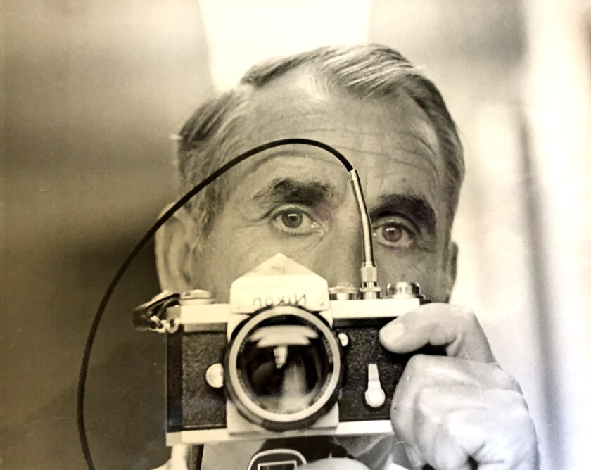Stanley Troutman takes a mirror selfie in 1974 with a 35mm Nikon F.