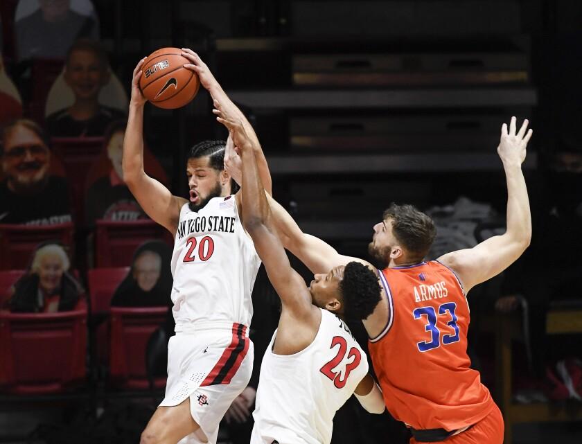 San Diego State guard Jordan Schakel (20) grabs a rebound.