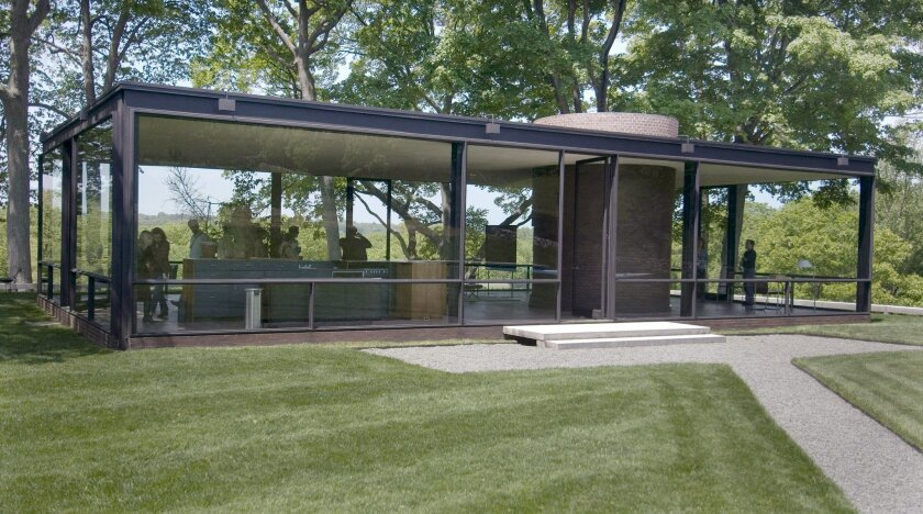 FILE - This May 23, 2007 file photo shows an exterior view of the Glass House in New Canaan, Conn. A May 12, 2016 approval from the local zoning board allows the Modernist landmark, designed in 1949 by the late architect Philip Johnson, to hold more events with small crowds and raises the cap on at