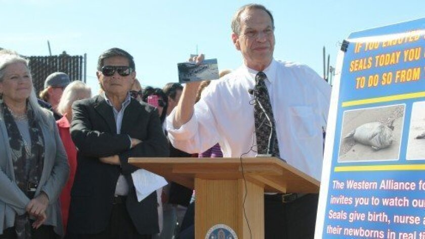 San Diego Mayor Bob Filner held a press conference at La Jolla Children's Pool beach earlier this year. At left is his former communications director, Irene McCormack Jackson, who has retained Los Angeles attorney Gloria Allred to represent her in a sexual harassment suit against the mayor