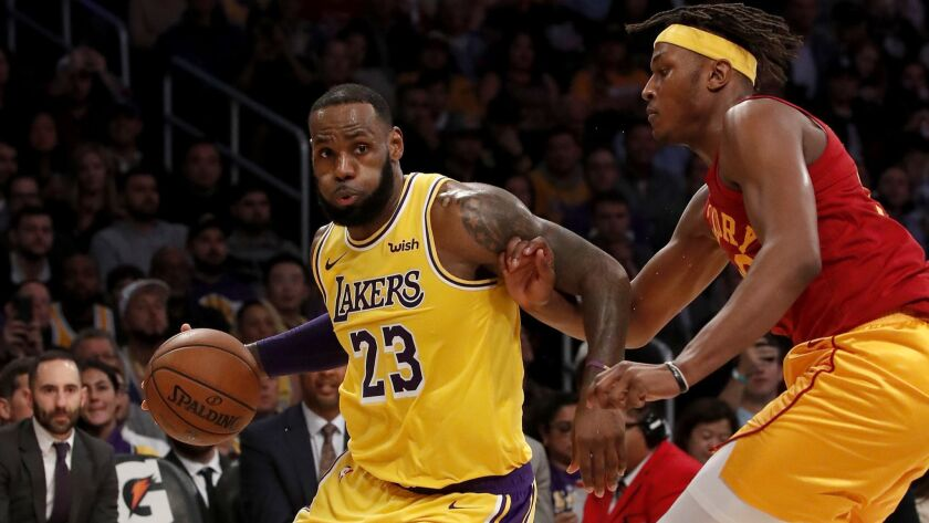 Lakers forward LeBron James drives to the basket against Indiana Pacers center Myles Turner at Staples Center on Nov. 29.