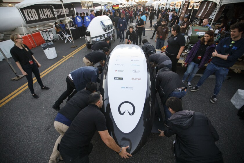 "UC Irvine ""UCI HyperXite"" team members push their pod during the Hyperloop Pod Competition by SpaceX in Hawthorne. College students worldwide competed to test their pods on a Hyperloop track that runs three-quarters of a mile."