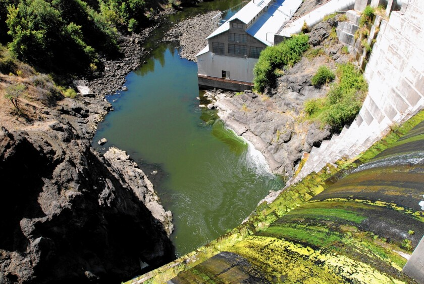 Water trickles over a dam on the Klamath River outside Hornbrook, Calif. The demise of a deal to end decades of feuding on the river could rekindle old battles over water use and dams in this remote corner of the state.