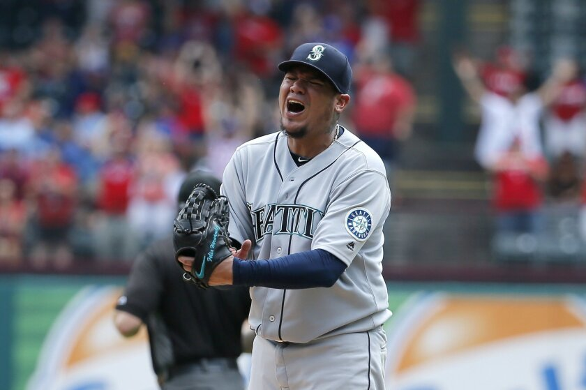 Seattle Mariners starting pitcher Felix Hernandez punches his glove after giving up a grand slam to Texas Rangers' Carlos Gomez in the fourth inning of a baseball game, Wednesday, Aug. 31, 2016, in Arlington, Texas. (AP Photo/Tony Gutierrez)