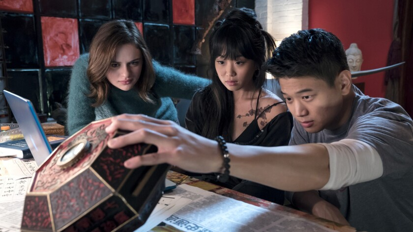 "Joey King, left, Alice Lee and Ki Hong Lee in the film ""Wish Upon."""