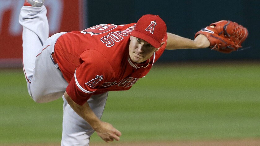 Starting pitcher Garrett Richards left the Angels' April 5 game against the Oakland Athletics in the fifth inning because of pain in his biceps.