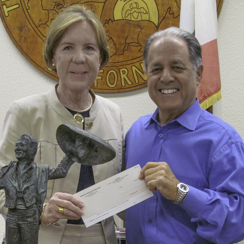 RSF Foundation Exec Director Christy Wilson presents a check to Don Diego Board Chair Jon Liss.