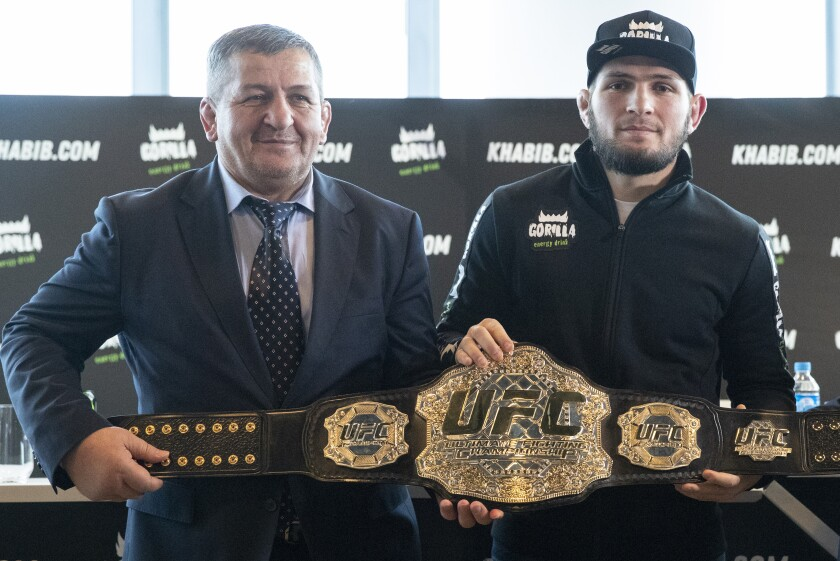 UFC lightweight champion Khabib Nurmagomedov, right, and his father Abdulmanap Nurmagomedov.