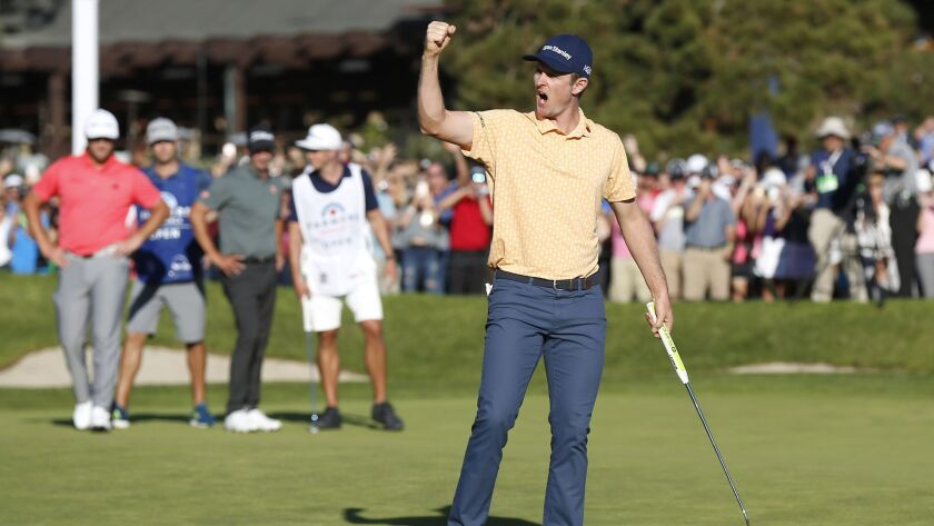 Justin Rose celebrates after a birdie on the 18th hole to win the Farmers Insurance Open at the Torrey Pines Golf Course on Jan. 27, 2019.