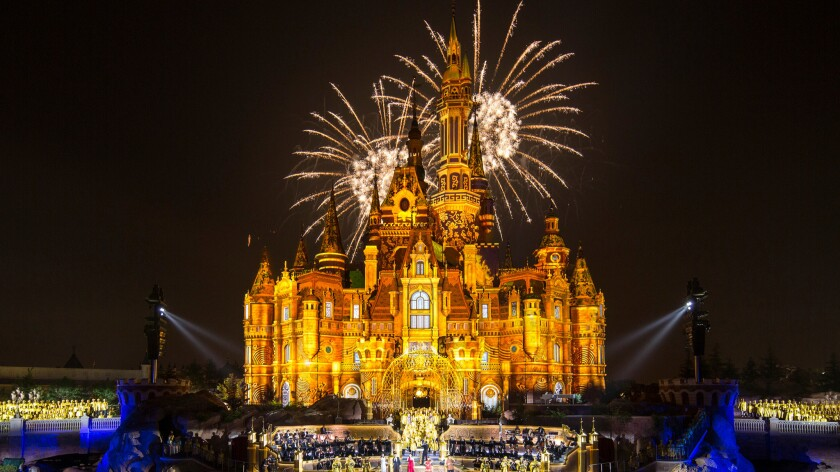 Nearly two months after opening Shanghai Disney Resort, Disney Imagineering has announced a round of layoffs. During the opening celebration for the resort, fireworks explode over the Enchanted Storybook Castle.