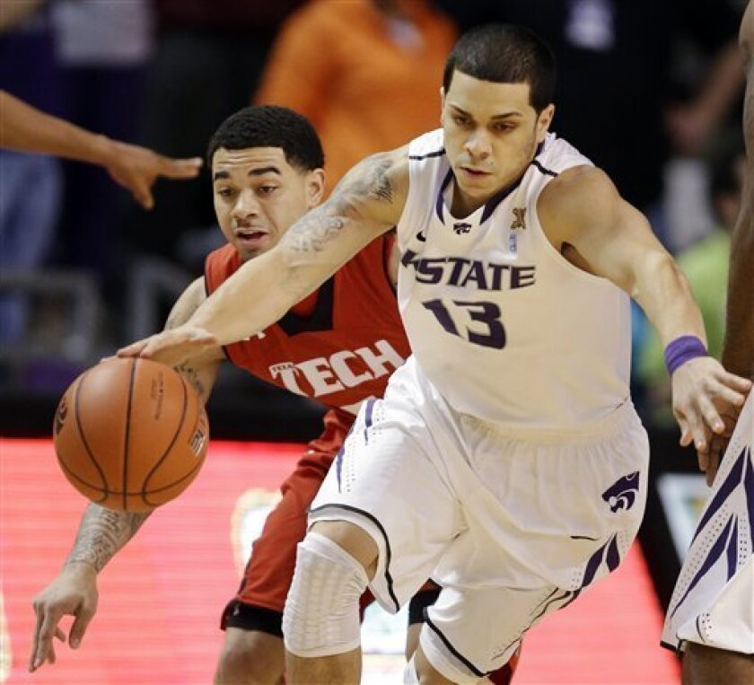 Kansas State guard Angel Rodriguez (13) is covered by Texas Tech guard Josh Gray during the first half of an NCAA college basketball game in Manhattan, Kan., Monday, Feb. 25, 2013. (AP Photo/Orlin Wagner)