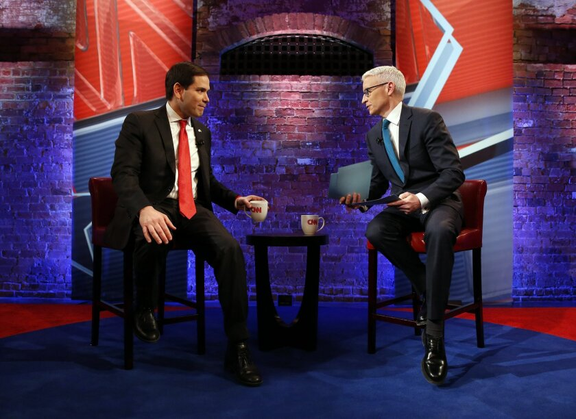 Republican presidential candidate, Sen. Marco Rubio, R-Fla., appears with Anderson Cooper during a commercial break at a CNN town hall event, Tuesday, Feb. 16, 2016, in Greenville, S.C. (AP Photo/Paul Sancya)