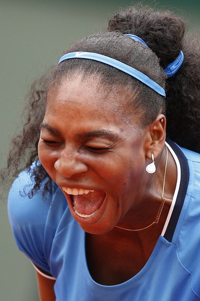 Serena Williams of the U.S. screams in the third round match of the French Open tennis tournament against France's Kristina Mladenovic at the Roland Garros stadium in Paris, France, Saturday, May 28, 2016. (AP Photo/Christophe Ena)