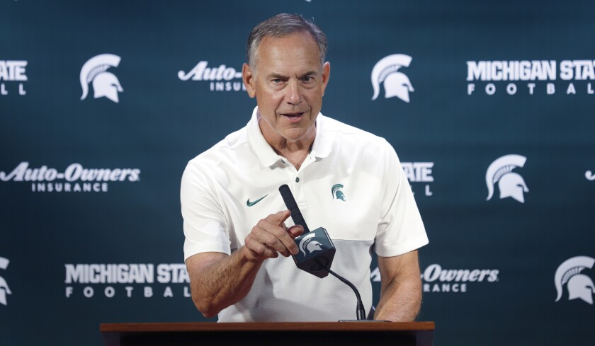 Michigan State football coach Mark Dantonio talks with reporters during the team's media day on Aug. 5.
