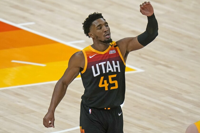 Utah Jazz guard Donovan Mitchell celebrates after dunking against the Los Angeles Lakers during the second half of an NBA basketball game Wednesday, Feb. 24, 2021, in Salt Lake City. (AP Photo/Rick Bowmer)