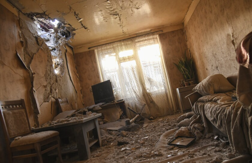Damages are seen inside an apartment in a residential area after shelling during a military conflict in self-proclaimed Republic of Nagorno-Karabakh, Stepanakert, Azerbaijan, Saturday, Oct. 3, 2020. The fighting is the biggest escalation in years in the decades-long dispute over the region, which lies within Azerbaijan but is controlled by local ethnic Armenian forces backed by Armenia. (David Ghahramanyan/NKR InfoCenter PAN Photo via AP)