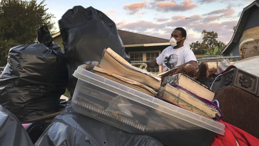 Steven Williams helps clear out his wife's grandmother's home after Hurricane Harvey flooded Port Arthur, Texas.