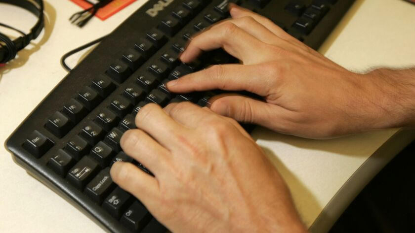 **FOR USE WITH AP LIFESTYLES** A man types on an office keyboard, Tuesday, July 29, 2008 in New Yor
