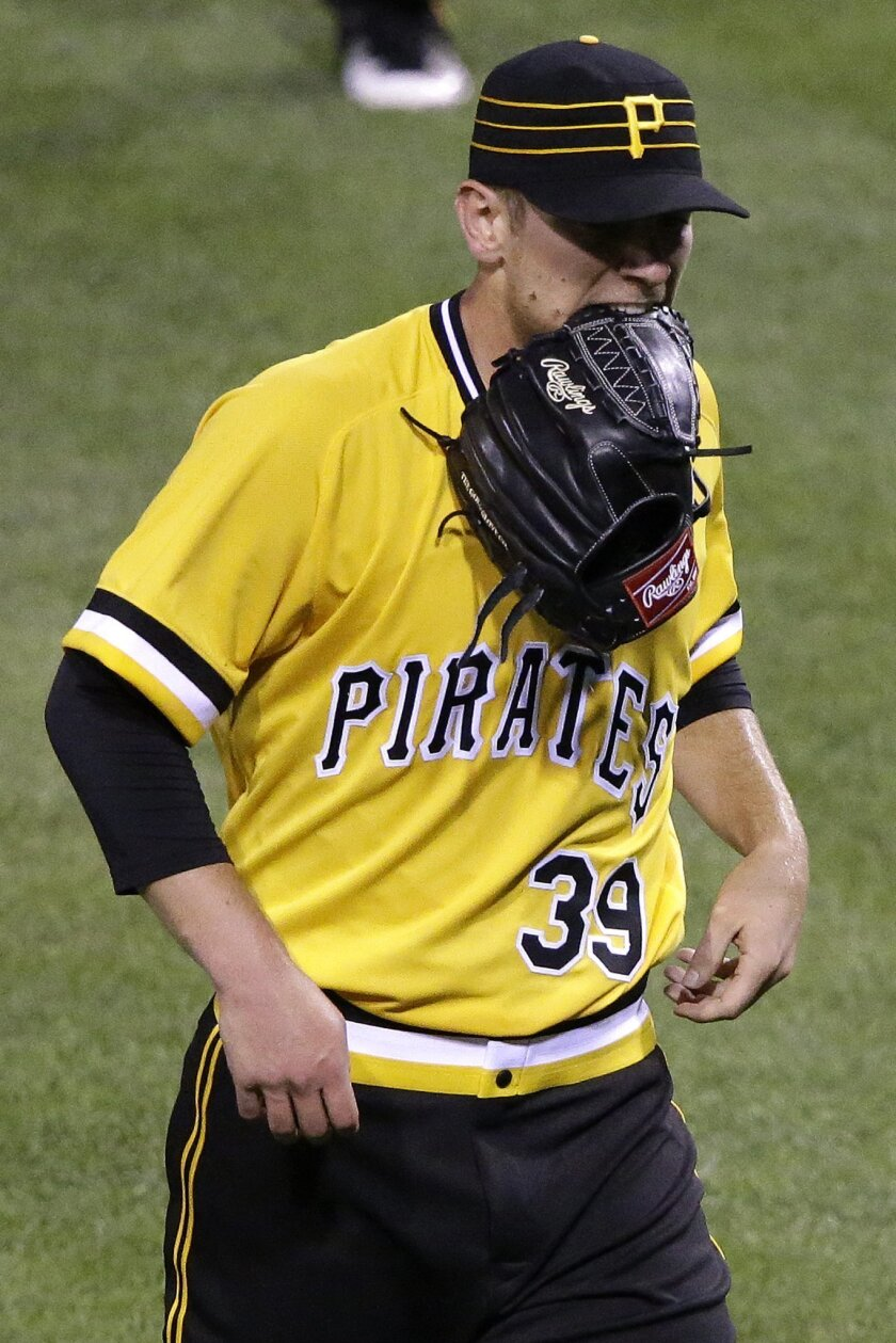 Pittsburgh Pirates starting pitcher Chad Kuhl walks to the dugout after giving up a two-run home run to Los Angeles Dodgers' Justin Turner in the third inning of a baseball game in Pittsburgh, Sunday, June 26, 2016. (AP Photo/Gene J. Puskar)