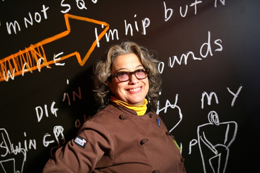Chef Susan Feniger poses for photographs at her now-closed restaurant Street. Feniger is turning the space into a new restaurant called Mud Hen Tavern.