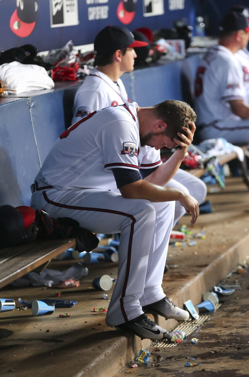 Atlanta Braves relief pitcher Bud Norris sits on the bench after being pulled in the eighth inning of baseball game against the Milwaukee Brewers on Wednesday, May 25, 2016, in Atlanta. (AP Photo/John Bazemore)