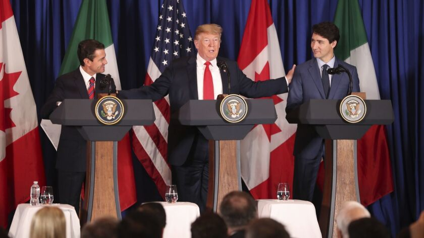 President Donald Trump, center, reaches out to Mexico's President Enrique Pena Nieto, left, and Cana