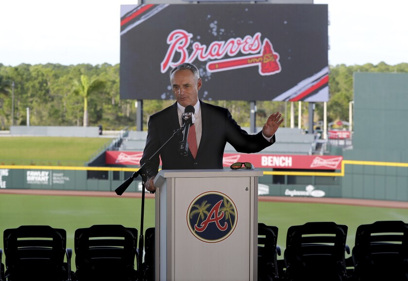 Major League Baseball Commissioner Rob Manfred speaks to reporters Sunday at the Atlanta Braves' spring training facility.