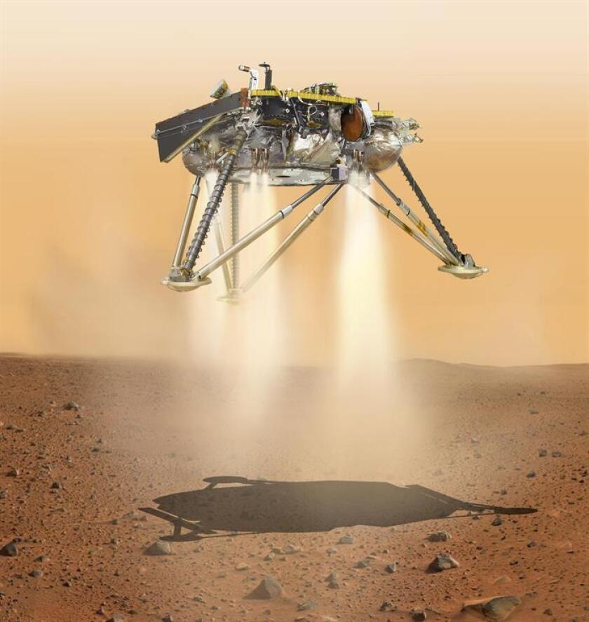 Fotografía cedida por la Administración Aeronáutica Espacial Nacional de EE.UU. (NASA) de una ilustración que muestra una visión simulada del aterrizaje del InSight en la superficie de Marte. EFE/NASA/JPL-Caltech