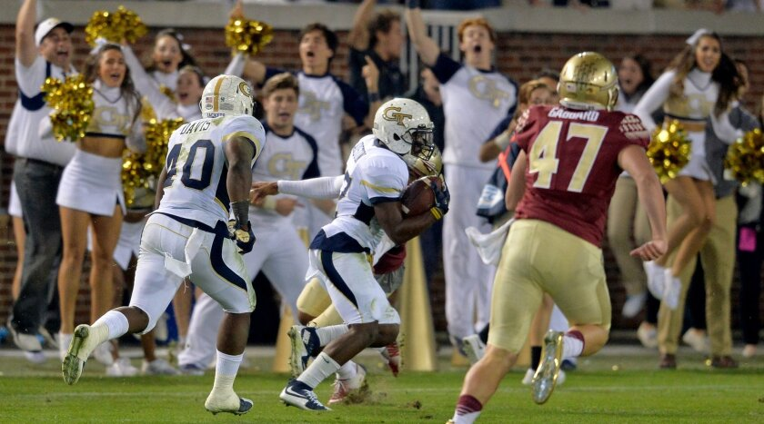 FILE - In this Oct. 24, 2015, file photo, Georgia Tech defensive back Lance Austin runs the ball toward the end zone for a touchdown after picking up a blocked Florida State field goal attempt during an NCAA college football game in Atlanta. Georgia Tech won 22-16. The once-in-a-lifetime play has b
