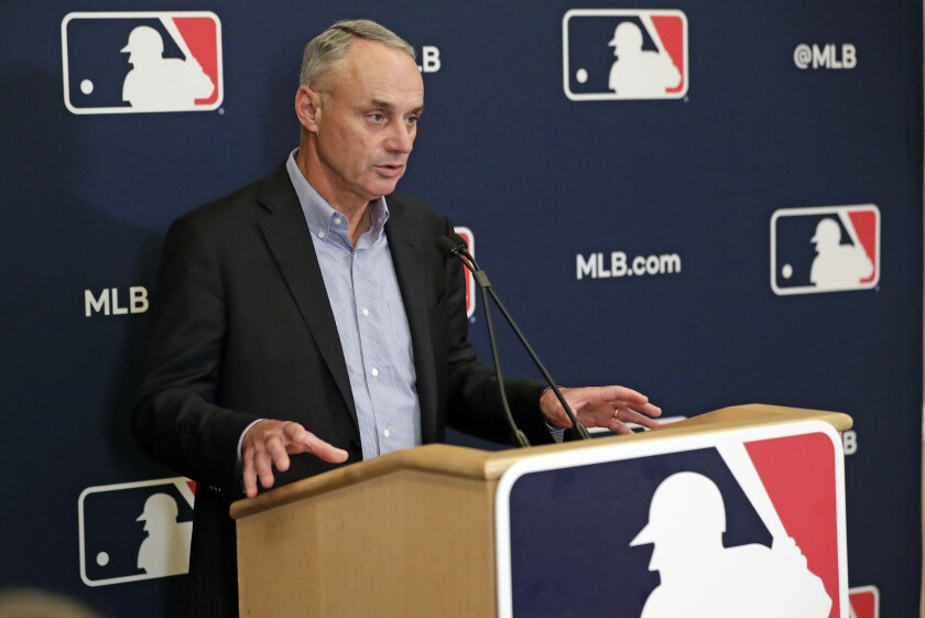 MLB commissioner Rob Manfred answers questions at a press conference  Feb. 6, 2020, in Orlando, Fla.