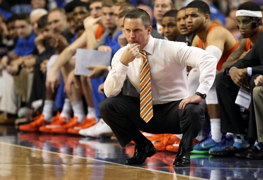 Florida's head coach Mike White watches his team during the second half of an NCAA college basketball game against Kentucky, Saturday, Feb. 6, 2016, in Lexington, Ky. Kentucky won 80-61. (AP Photo/James Crisp)