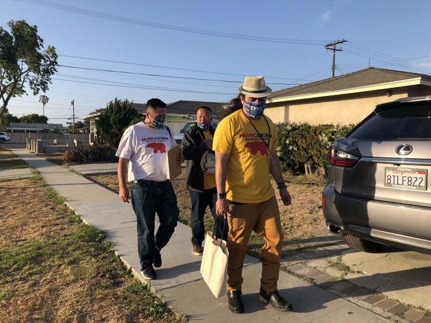 Pierre Sandoval, David Nguyen and Douglas Jessop go door to door in Gardena.
