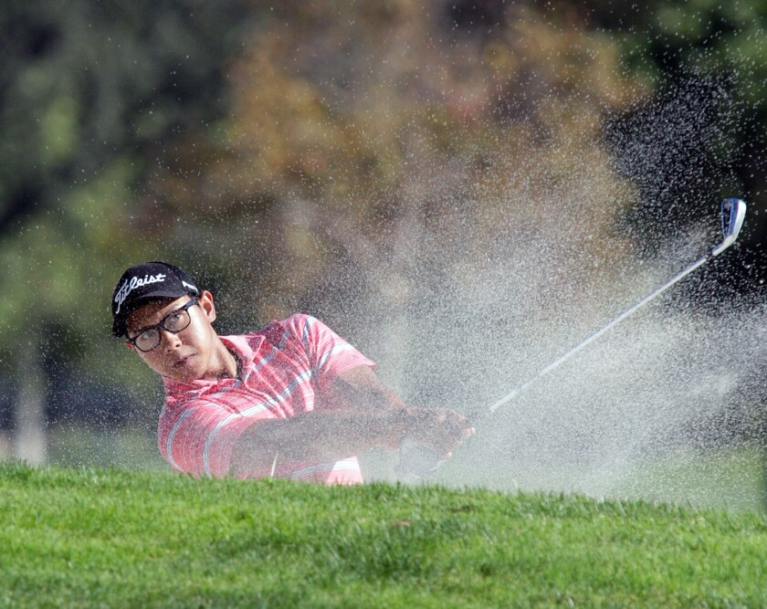 Win Kyaw hits out of a bunker on the 12th at the Glendale City Golf Championship at Oakmont Country Club in Glendale on Monday, Aug. 24, 2015.