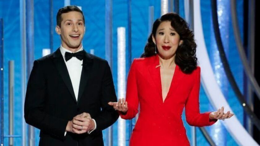 Hosts Andy Samberg and Sandra Oh speak onstage during the 76th Golden Globes at the Beverly Hilton on Jan. 6.