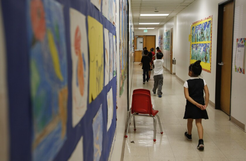 Students walk down a hallway at Metro Charter Elementary School in downtown Los Angeles.