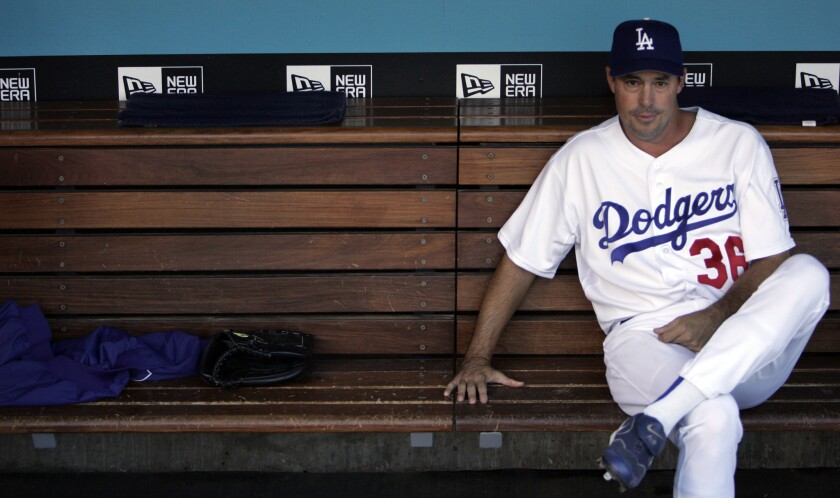 Greg Maddux, shown in the dugout in 2006, is back with the Dodgers, this time in the front office.