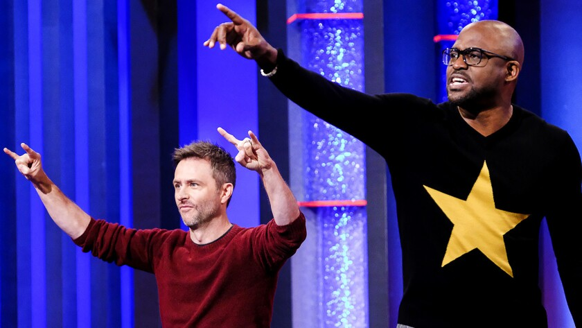 "Chris Hardwick, left, and Wayne Brady in ""Who's Line is it Anyway?"" on CW."